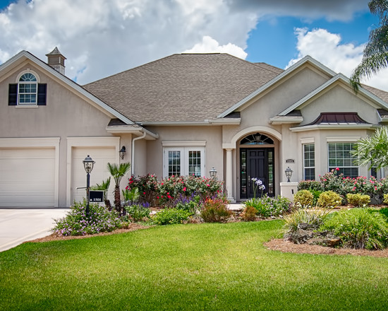 Simple blease loop the villages home front yard for Garage in front of house