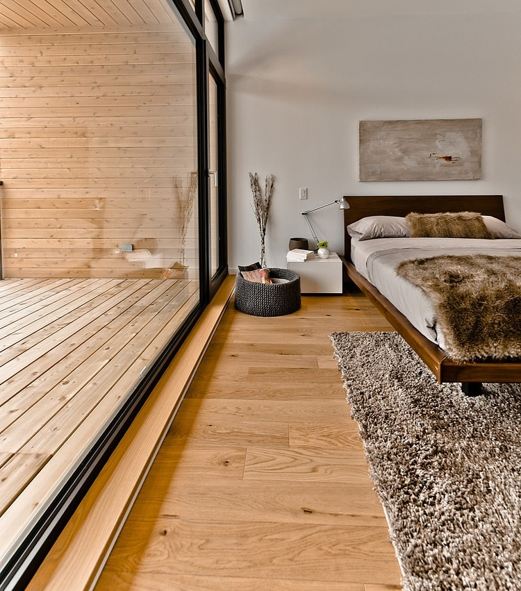 cozy bedroom in white and wood interior design style featured with