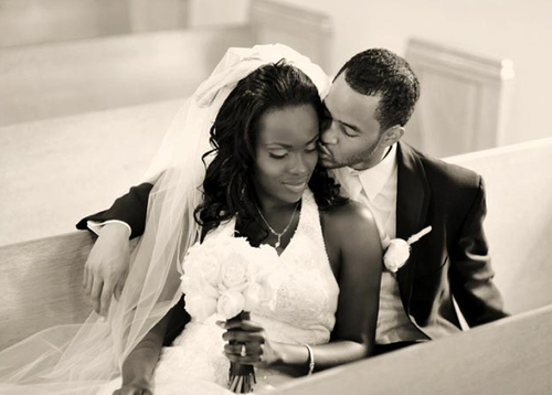 Bride-groom-sitting-pews-church-kissing_large