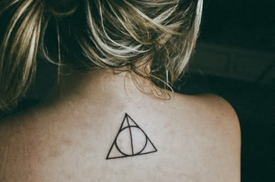 Deathly-hallows-girl-hair-harry-potter-small-tattoo-favim.com-118052_large