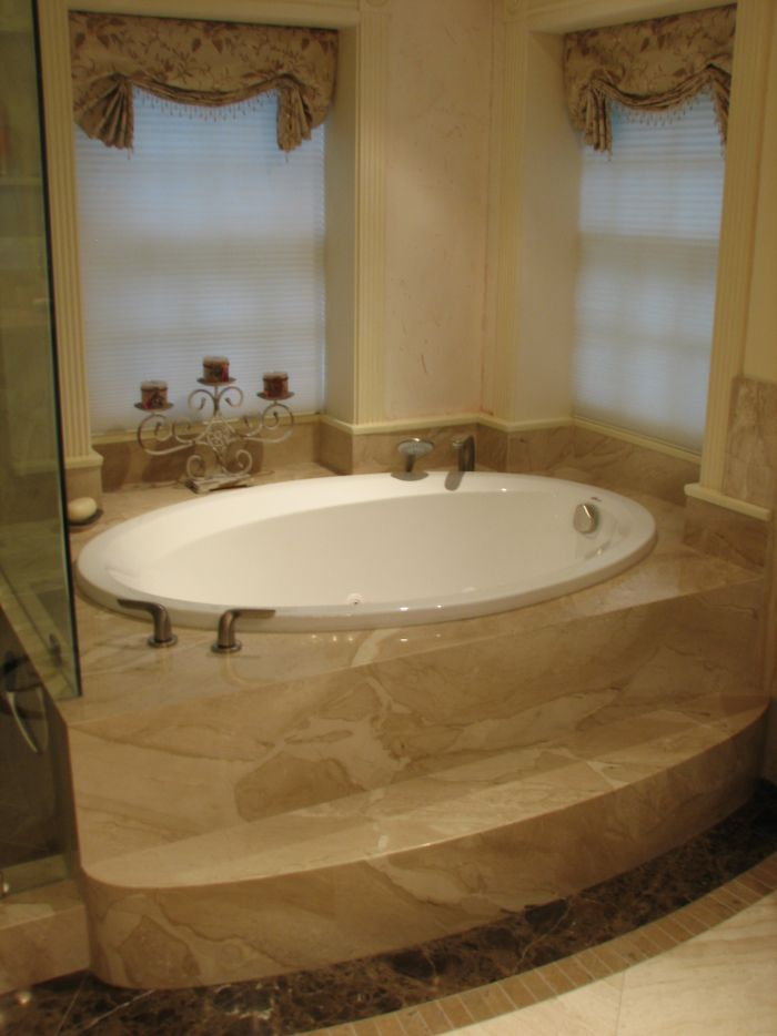 Classy small bathroom design ideas featuring white oval jacuzzi tub with marble deck and ancient - Bathroom designs with jacuzzi tub ...