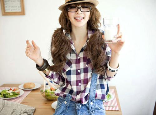 Cute tan asian girl in glasses