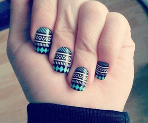Stunning Aztec tribal print nails.