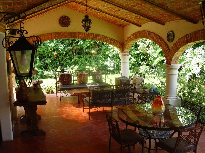 architecture spanish hacienda patio design ideas with unique brick ceiling and honeycomb floor pattern featuring round glass table and wooden console table