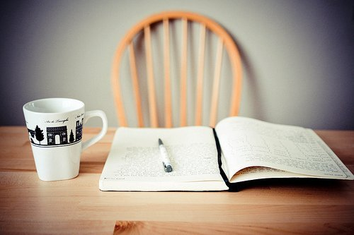 journal and coffee