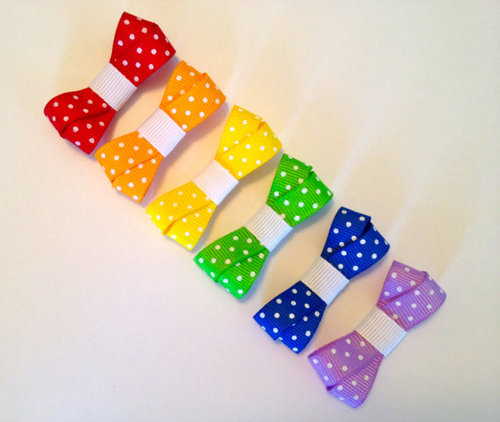 Cute rainbow polka dot mini bows by BrownEyedBowtique on Etsy