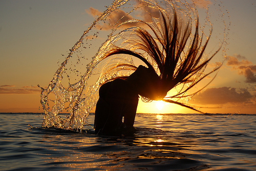 Sunset-girl-bathing-sea-beautiful_large