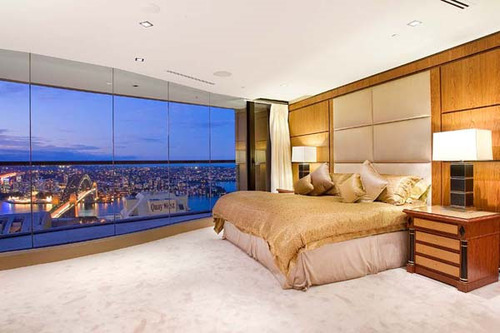Interior-luxury-bedrooms-with-large-beds-and-luxurious-rooms-with-large-windows-overlooking-the-city-sidney_large