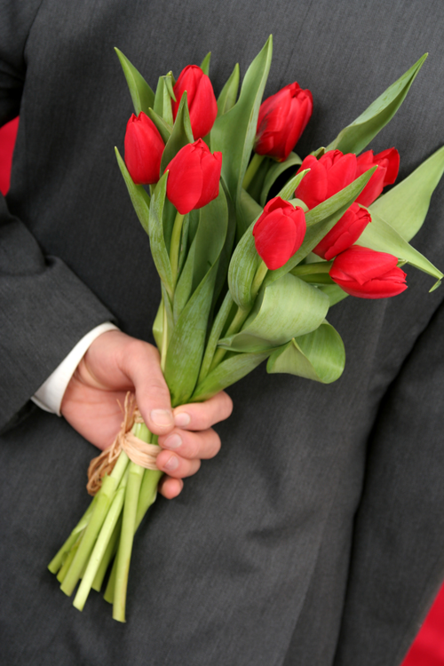 Bigstockphoto_man_holding_flowers_344282-resized-600_large