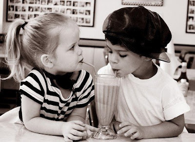 http://data.whicdn.com/images/34927208/Little_Kids_Sharing_a_Shake_-_Black___White_Picture_-_Little_Girl_-_Little_Boy_with_Hat_large.jpg