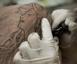 mucha tattoo in progress