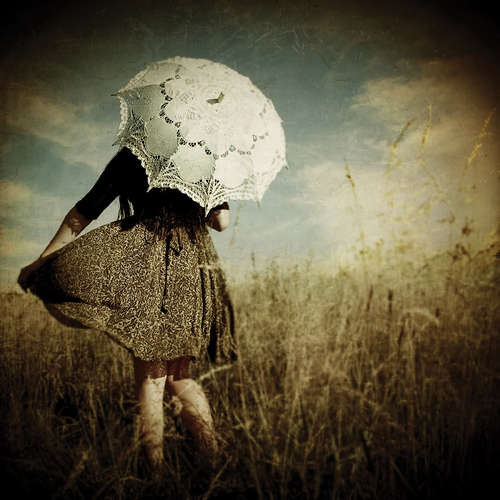 Vintage_background_yellow_fields_girl_white_umbrella_large
