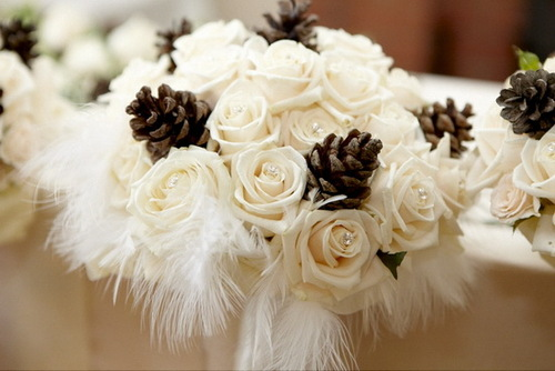 Cream_roses_and_pine_cones_winter_wedding_bouquet_with_white_feathers_large