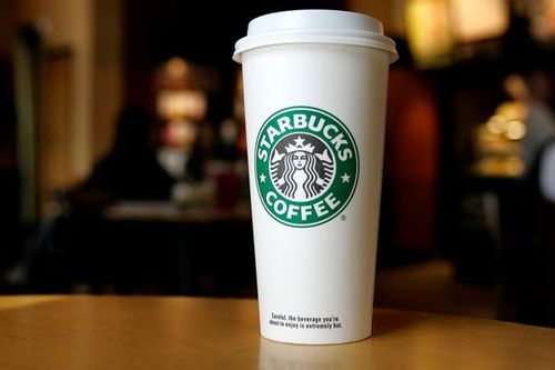 A_cup_displaying_the_starbucks_coffee_logo_large