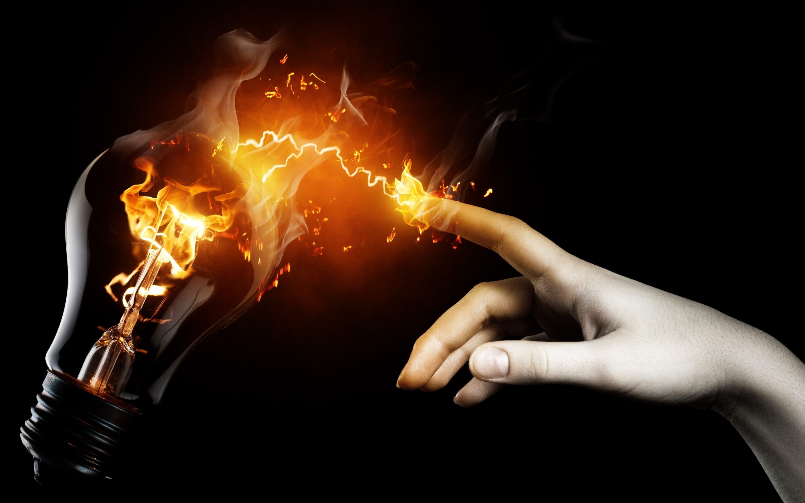 Hand With Fire Spark Touching Lamp Wallpaper And Photo