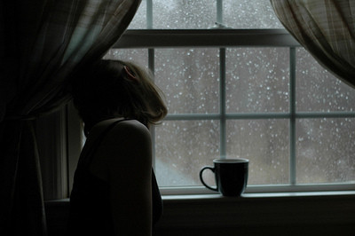 Female,looking,out,mug,pensive,window,bad,weather-56bc4c1a07c32fde323d11a63fbd8587_h_large
