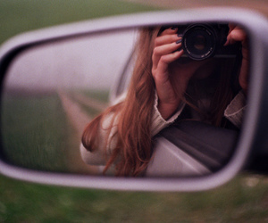 a car, a camera and a world to photograph