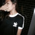 × Ē L ×
