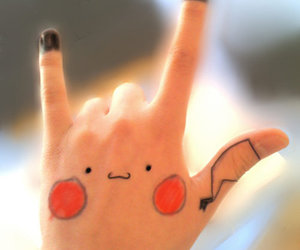 hand and pikachu image