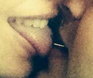 couple, Piercings, and kiss image