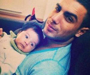 baby and papa image