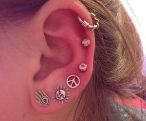 earrings, peace, and piercing image