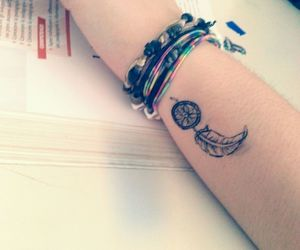 bracelets, dream catcher, and tattoo image