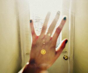 hand, light, and window image