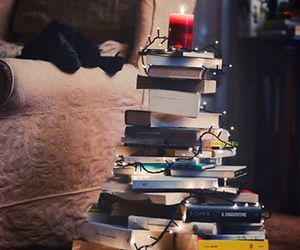 books, candle, and light image