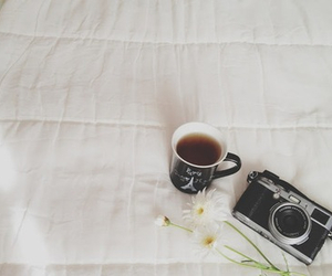 camera, flowers, and cup image
