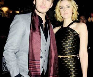 jena malone, sam claflin, and the hunger games image