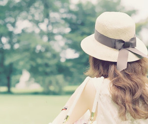curls and white hat image
