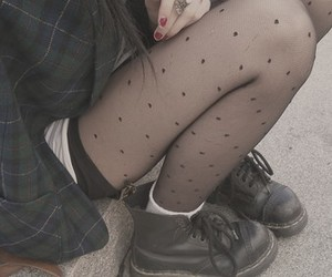 boots, ripped tights, and fashion image