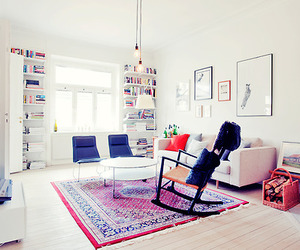 bookshelf, couch, and rug image