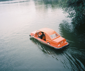car, water, and boat image