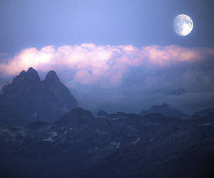moon, clouds, and mountains image