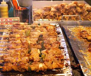 south korea, korean food, and chicken skewers image