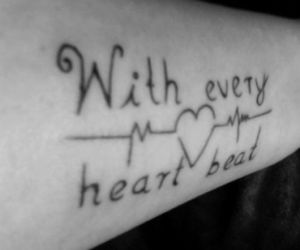 tattoo and with every heartbeat image