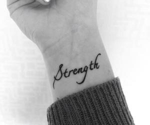 strong, Tattoos, and wrist image