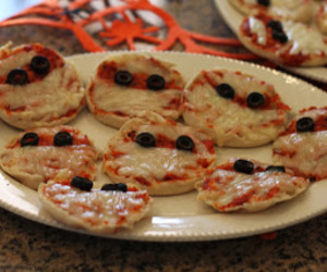 halloween party and pizza coupons image