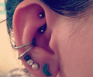 conch peircing and rook peircing image