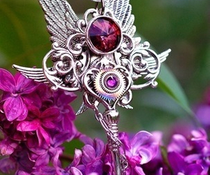 key, purple, and wings image