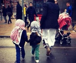 father and muslim kids image
