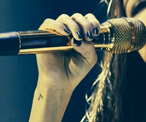 selena gomez, microphone, and tattoo image