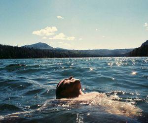 water, boy, and lake image