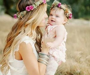 mother, baby, and flowers image