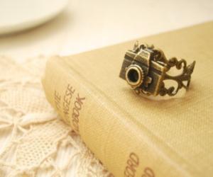 camera, book, and ring image