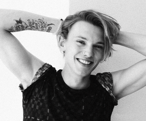 Jamie Campbell Bower, smile, and tattoo image