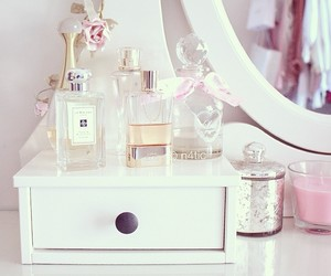 perfume, candle, and design image
