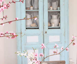 pink buds and blue cupboard image